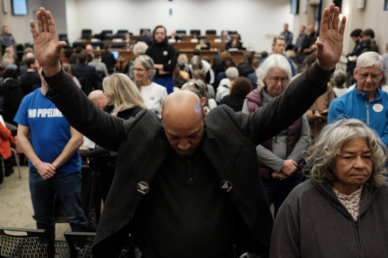 Richard Walker and other opponents of a proposed Atlantic Coast Pipeline compressor station in Buckingham County protested at a State Air Pollution Control Board meeting in December by standing and turning their backs during a Department of Environmental Quality presentation.